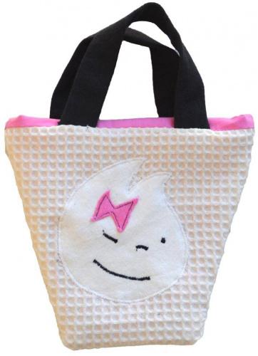 Petit sac avec tête espiègle